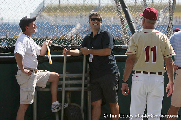 Karl Ravech talks with Robin Ventura and FSU coach Mike Martin during the Gators' pre-College World Series practice on Friday, June 18, 2010 at Rosenblatt Stadium in Omaha, Neb. / photo by Tim Casey