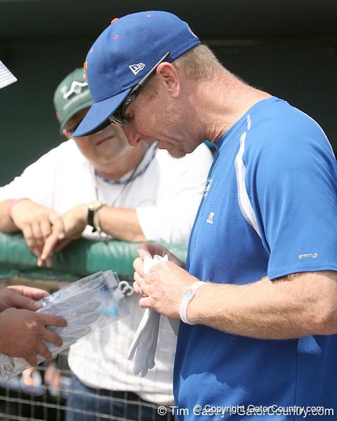 Florida baseball equipment manager Edmund Boyd unwraps new batting gloves during the Gators' pre-College World Series practice on Friday, June 18, 2010 at Rosenblatt Stadium in Omaha, Neb. / photo by Tim Casey