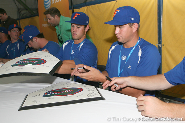 Florida sophomore Preston Tucker and freshman pitcher Brian Johnson sign autographs during the Gators' pre-College World Series practice on Friday, June 18, 2010 at Rosenblatt Stadium in Omaha, Neb. / photo by Tim Casey
