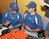 Florida senior catcher Hampton Tignor and senior Matt den Dekker sign autographs during the Gators' pre-College World Series practice on Friday, June 18, 2010 at Rosenblatt Stadium in Omaha, Neb. / photo by Tim Casey