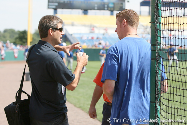 Karl Ravech talks with Jeff Cardozo during the Gators' pre-College World Series practice on Friday, June 18, 2010 at Rosenblatt Stadium in Omaha, Neb. / photo by Tim Casey