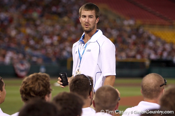 Florida senior pitcher Chas Spottswood takes a photograph during the College World Series Opening Ceremonies on Friday, June 18, 2010 at Rosenblatt Stadium in Omaha, Neb. / photo by Tim Casey
