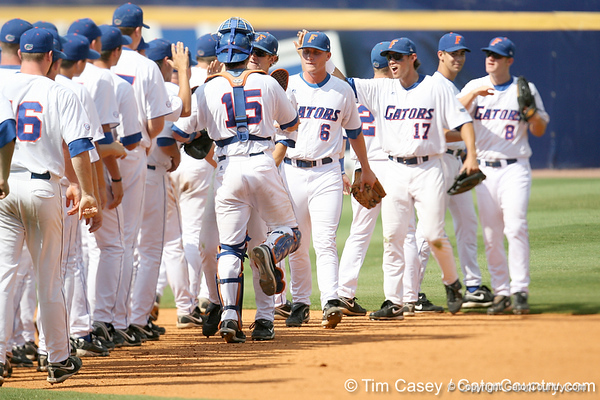 Florida senior outfielder Jonathan Pigott celebrates with teammates after making a diving catch to start a game-ending double play during the Gators' 5-4 win against the Arkansas Razorbacks in the SEC Tournament on Thursday, May 27, 2010 at Regions Park in Hoover, Ala. / Gator Country photo by Tim Casey