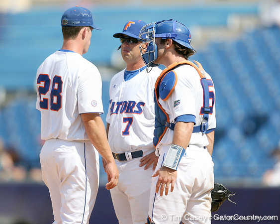 Florida baseball head coach Kevin O'Sullivan talks to senior pitcher Jeff Barfield during the Gators' 5-4 win against the Arkansas Razorbacks in the SEC Tournament on Thursday, May 27, 2010 at Regions Park in Hoover, Ala. / Gator Country photo by Tim Casey