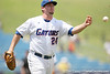 Florida sophomore pitcher Alex Panteliodis throws out a runner at first base during the Gators' 5-4 win against the Arkansas Razorbacks in the SEC Tournament on Thursday, May 27, 2010 at Regions Park in Hoover, Ala. / Gator Country photo by Tim Casey