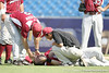 Arkansas third baseman Andy Wilkins lies injured after a collision during the Gators' 5-4 win against the Arkansas Razorbacks in the SEC Tournament on Thursday, May 27, 2010 at Regions Park in Hoover, Ala. / Gator Country photo by Tim Casey