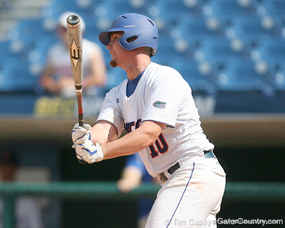 Florida freshman Austin Maddox hits a ground ball to second base during the Gators' 5-4 win against the Arkansas Razorbacks in the SEC Tournament on Thursday, May 27, 2010 at Regions Park in Hoover, Ala. / Gator Country photo by Tim Casey