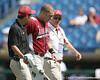 Arkansas third baseman Andy Wilkins is helped off of the field after a collision during the Gators' 5-4 win against the Arkansas Razorbacks in the SEC Tournament on Thursday, May 27, 2010 at Regions Park in Hoover, Ala. / Gator Country photo by Tim Casey