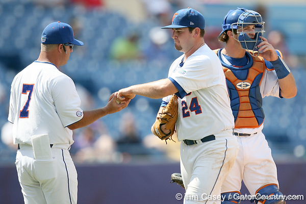 Florida sophomore pitcher Alex Panteliodis hands the ball to head coach Kevin O'Sullivan during the Gators' 5-4 win against the Arkansas Razorbacks in the SEC Tournament on Thursday, May 27, 2010 at Regions Park in Hoover, Ala. / Gator Country photo by Tim Casey
