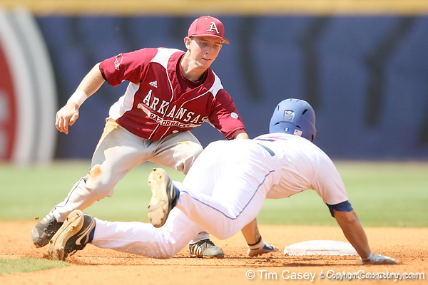 Florida junior Josh Adams gets tagged out by Arkansas shortstop Tim Carver after being caught stealing during the Gators' 5-4 win against the Arkansas Razorbacks in the SEC Tournament on Thursday, May 27, 2010 at Regions Park in Hoover, Ala. / Gator Country photo by Tim Casey