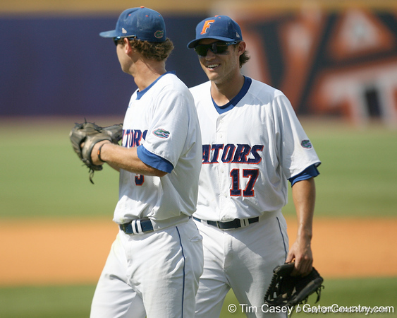 Florida senior outfielder Jonathan Pigott celebrates with senior Matt den Dekker after making a diving catch to start a game-ending double play during the Gators' 5-4 win against the Arkansas Razorbacks in the SEC Tournament on Thursday, May 27, 2010 at Regions Park in Hoover, Ala. / Gator Country photo by Tim Casey