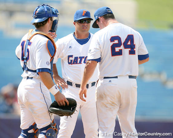 Florida baseball head coach Kevin O'Sullivan talks with sophomore pitcher Alex Panteliodis during the Gators' 5-4 win against the Arkansas Razorbacks in the SEC Tournament on Thursday, May 27, 2010 at Regions Park in Hoover, Ala. / Gator Country photo by Tim Casey