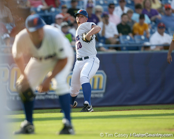 Florida freshman catcher Austin Maddox fields a bunt during the Gators' 10-6 loss to the LSU Tigers in the SEC Tournament on Wednesday, May 26, 2010 at Regions Park in Hoover, Ala. / Gator Country photo by Tim Casey