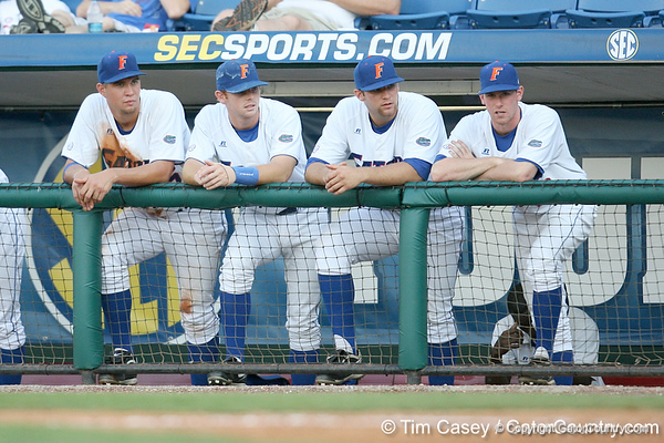 Brian Johnson, Bryson Smith, Steven Rodriguez and Anthony DeSclafani watch from the dugout during the Gators' 10-6 loss to the LSU Tigers in the SEC Tournament on Wednesday, May 26, 2010 at Regions Park in Hoover, Ala. / Gator Country photo by Tim Casey