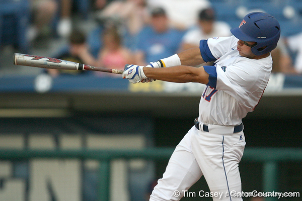 Florida senior Matt den Dekker hits a solo home run during the eighth inning of Gators' 10-6 loss to the LSU Tigers in the SEC Tournament on Wednesday, May 26, 2010 at Regions Park in Hoover, Ala. / Gator Country photo by Tim Casey