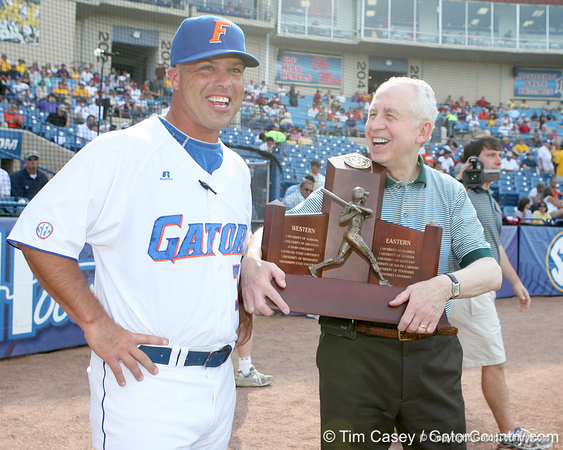 Florida baseball head coach Kevin O'Sullivan accepts the SEC Championship Trophy from commishioner Mike Slive before the Gators' 10-6 loss to LSU in the SEC Tournament on Wednesday, May 26, 2010 at Regions Park in Hoover, Ala. / Gator Country photo by Tim Casey