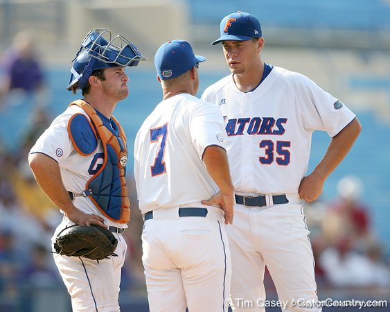 Florida sophomore catcher Ben McMahan and pitcher Brian Johnson listen to head coach Kevin O'Sullivan (7) during the Gators' 10-6 loss to the LSU Tigers in the SEC Tournament on Wednesday, May 26, 2010 at Regions Park in Hoover, Ala. / Gator Country photo by Tim Casey
