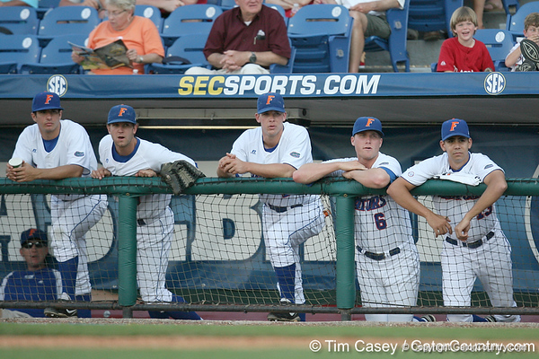 Jeff Barfield, Kevin Chapman and Tommy Toledo watch from the dugout during the Gators' 10-6 loss to the LSU Tigers in the SEC Tournament on Wednesday, May 26, 2010 at Regions Park in Hoover, Ala. / Gator Country photo by Tim Casey