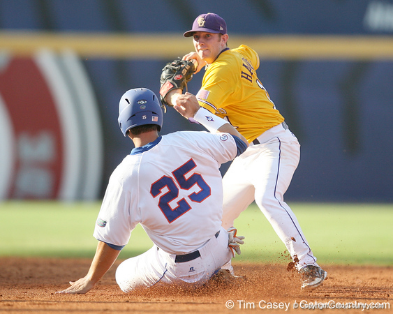 LSU second baseman Tyler Hanover attempts to turn a double play as Florida sophomore Preston Tucker slide into second during the fourth inning of Gators' 10-6 loss to the Tigers in the SEC Tournament on Wednesday, May 26, 2010 at Regions Park in Hoover, Ala. / Gator Country photo by Tim Casey