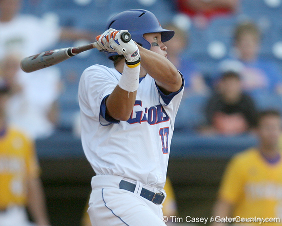 Florida senior Matt den Dekker hits a double to left field during the Gators' 10-6 loss to the LSU Tigers in the SEC Tournament on Wednesday, May 26, 2010 at Regions Park in Hoover, Ala. / Gator Country photo by Tim Casey