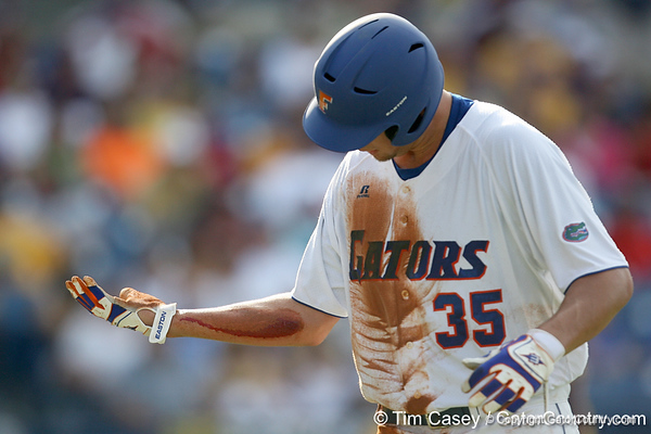 Florida freshman pitcher Brian Johnson gets treated for an open cut during the Gators' 10-6 loss to the LSU Tigers in the SEC Tournament on Wednesday, May 26, 2010 at Regions Park in Hoover, Ala. / Gator Country photo by Tim Casey
