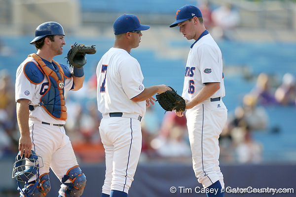 Florida baseball head coach Kevin O'Sullivan hands the ball to sophomore pitcher Anthony DeSclafani during the Gators' 10-6 loss to the LSU Tigers in the SEC Tournament on Wednesday, May 26, 2010 at Regions Park in Hoover, Ala. / Gator Country photo by Tim Casey