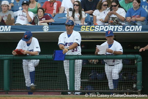 Florida baseball assistant coach Craig Bell signals to the defense during the Gators' 10-6 loss to the LSU Tigers in the SEC Tournament on Wednesday, May 26, 2010 at Regions Park in Hoover, Ala. / Gator Country photo by Tim Casey