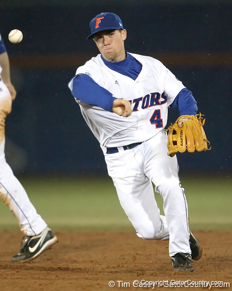 Florida freshman infielder Nolan Fontana turns a double play during the Gators' game against the UCF Knights on Wednesday, February 24, 2010 at McKethan Stadium in Gainesville, Fla. / Gator Country photo by Tim Casey
