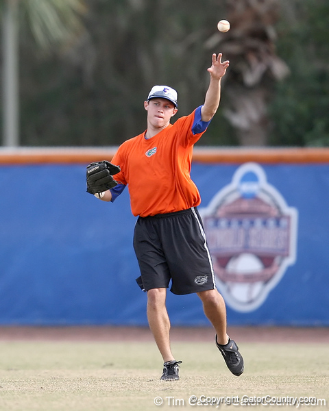 Florida senior Matt den Dekker throws to the infield during the Gators' first day of practice on Friday, January 29, 2010 at McKethan Stadium in Gainesville, Fla. / Gator Country photo by Tim Casey
