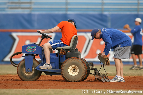 Florida baseball equipment manager Edmund Boyd helps prepare the infield during the Gators' first day of practice on Friday, January 29, 2010 at McKethan Stadium in Gainesville, Fla. / Gator Country photo by Tim Casey