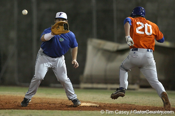 Florida sophomore Preston Tucker fields a throw at first base during the Gators' first day of practice on Friday, January 29, 2010 at McKethan Stadium in Gainesville, Fla. / Gator Country photo by Tim Casey