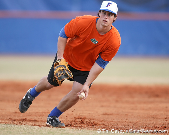 Florida sophomore Preston Tucker flips the ball the first base during the Gators' first day of practice on Friday, January 29, 2010 at McKethan Stadium in Gainesville, Fla. / Gator Country photo by Tim Casey