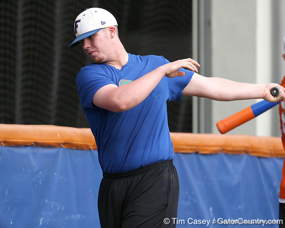 Florida freshman catcher Austin Maddox warms up during the Gators' first day of practice on Friday, January 29, 2010 at McKethan Stadium in Gainesville, Fla. / Gator Country photo by Tim Casey