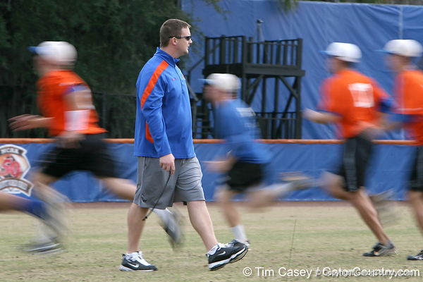 Florida baseball strength & conditioning coordinator Paul Chandler oversees warm-ups during the Gators' first day of practice on Friday, January 29, 2010 at McKethan Stadium in Gainesville, Fla. / Gator Country photo by Tim Casey
