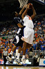 (Casey Brooke Lawson / Gator Country) UF forward Kenny Kadji scores over a Longwood player during the second half of the Gators games against Lancers in Gainesville, Fla., on January 6, 2009. The Gators won 95 to 69.