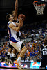 (Casey Brooke Lawson / Gator Country) UF forward Nick Calathes scores over a Longwood player during the second half of the Gators games against Lancers in Gainesville, Fla., on January 6, 2009. The Gators won 95 to 69.