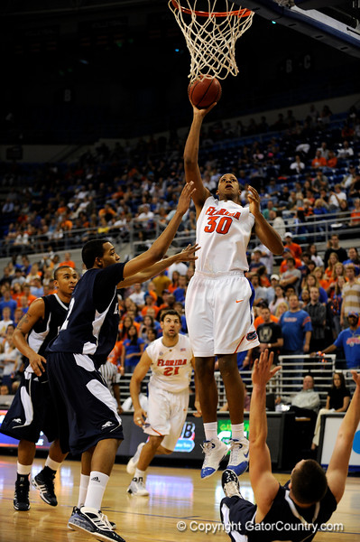 (Casey Brooke Lawson / Gator Country) UF forward Kenny Kadji scores over a Longwood player during the half time of the Gators games against Lancers in Gainesville, Fla., on January 6, 2009.