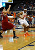 (Casey Brooke Lawson / Gator Country) UF forward Alex Tyus moves the ball past North Carolina State forward Ben McCauley during the first half of the Gators game against the Wolfpack in Gainesville, Fla., on January 3, 2009. The Gators won 68 to 66.
