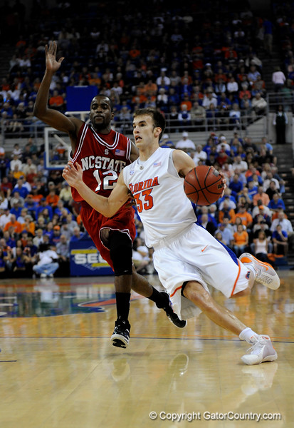 (Casey Brooke Lawson / Gator Country) UF forward Nick Calathes moves the ball past North Carolina State guard Farnold Degand during the first half of the Gators game against the Wolfpack in Gainesville, Fla., on January 3, 2009. The Gators won 68 to 66.