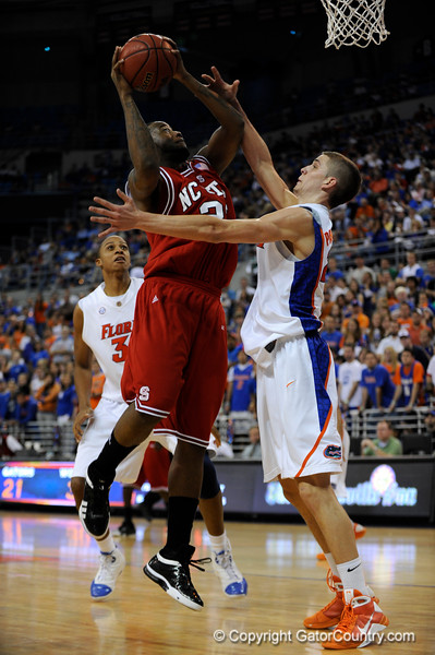 (Casey Brooke Lawson / Gator Country) UF forward Chandler Parsons blocks over North Carolina State forward Tracy Smith during the first half of the Gators game against the Wolfpack in Gainesville, Fla., on January 3, 2009. The Gators won 68 to 66.