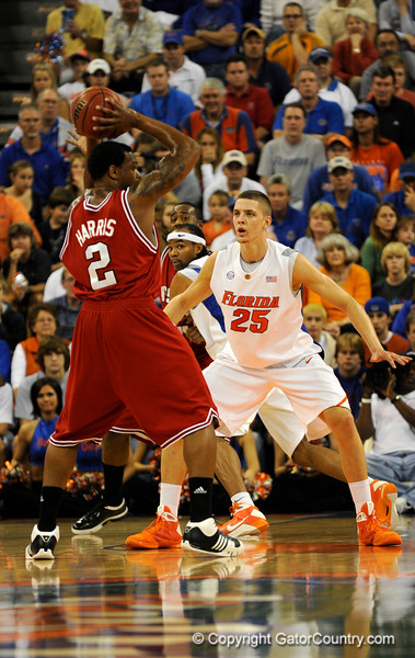 (Casey Brooke Lawson / Gator Country) UF forward Chandler Parsons defends against North Carolina State forward Simon Harris during the first half of the Gators game against the Wolfpack in Gainesville, Fla., on January 3, 2009. The Gators won 68 to 66.