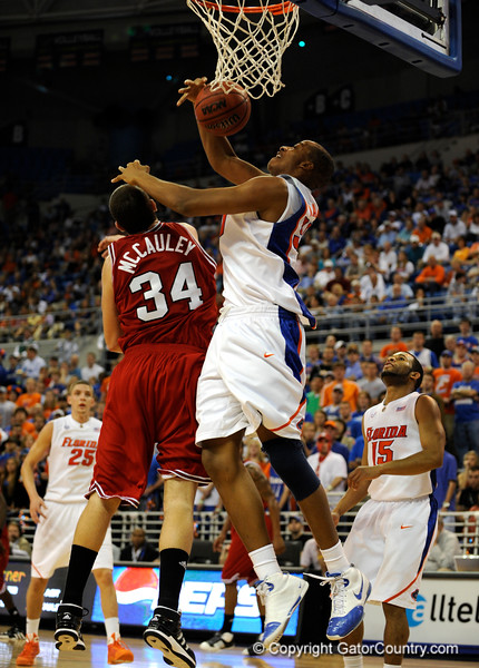 (Casey Brooke Lawson / Gator Country) UF forward Kenny Kadji scores over North Carolina State forward Ben mcCauley during the first half of the Gators game against the Wolfpack in Gainesville, Fla., on January 3, 2009. The Gators won 68 to 66.