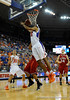 (Casey Brooke Lawson / Gator Country) UF forward Alex Tyus scores over a North Carolina State player during the first half of the Gators game against the Wolfpack in Gainesville, Fla., on January 3, 2009. The Gators won 68 to 66.