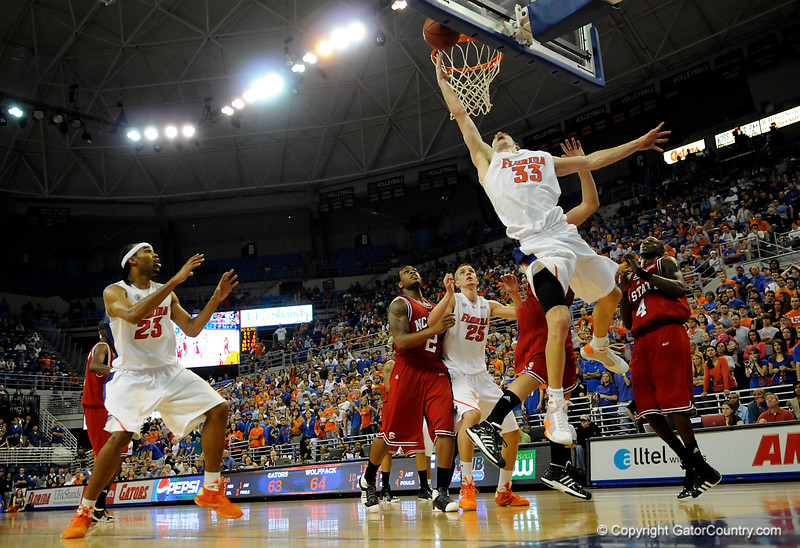 (Casey Brooke Lawson / Gator Country) UF forward Nick Calathes scores over a North Carolina State forward Courtney Fells during the second half of the Gators game against the Wolfpack in Gainesville, Fla., on January 3, 2009. The Gators won 68 to 66.