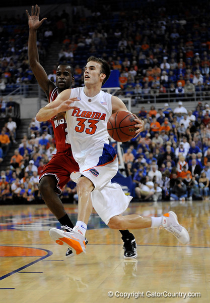 (Casey Brooke Lawson / Gator Country) UF forward Nick Calathes moves the ball past a North Carolina State player during the first half of the Gators game against the Wolfpack in Gainesville, Fla., on January 3, 2009. The Gators won 68 to 66.