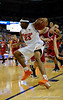 (Casey Brooke Lawson / Gator Country) UF forward Alex Tyus moves the ball past a North Carolina State player during the first half of the Gators game against the Wolfpack in Gainesville, Fla., on January 3, 2009. The Gators won 68 to 66.