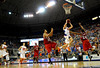 (Casey Brooke Lawson / Gator Country) UF forward Chandler Parsons scores over North Carolina State forward Brandon Costner and guard Julius Mays during the second half of the Gators game against the Wolfpack in Gainesville, Fla., on January 3, 2009. The Gators won 68 to 66.