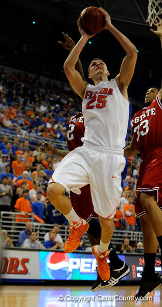 (Casey Brooke Lawson / Gator Country) UF forward Chandler Parsons scores over a North Carolina State player during the first half of the Gators game against the Wolfpack in Gainesville, Fla., on January 3, 2009. The Gators won 68 to 66.