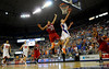 (Casey Brooke Lawson / Gator Country) UF forward Chandler Parsons scores over North Carolina State forward Brandon Costner during the second half of the Gators game against the Wolfpack in Gainesville, Fla., on January 3, 2009. The Gators won 68 to 66.