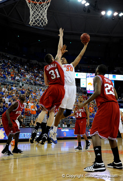 (Casey Brooke Lawson / Gator Country) UF forward Kenny Kadji scores over North Carolina State forward Dennis Horner during the first half of the Gators game against the Wolfpack in Gainesville, Fla., on January 3, 2009. The Gators won 68 to 66.